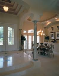 unusually tall ceilings and decorative marble columns open up the