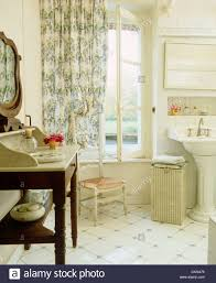 Bathroom In French by Marble Topped Washstand And White Tiled Floor In French Country
