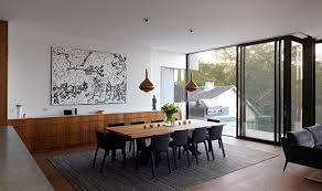 Modern House Dining Room - this house hides multiple levels behind its minimal street facade
