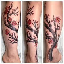 cherry blossom tree on lower leg and piercing