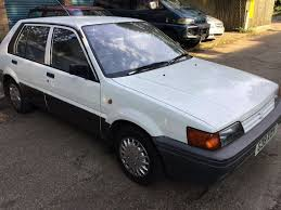 nissan sunny premium 1392cc petrol 5 speed manual 5 door hatchback