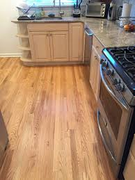 oak kitchen cabinets with oak flooring kitchen unfinished oak planks replace gray tiles