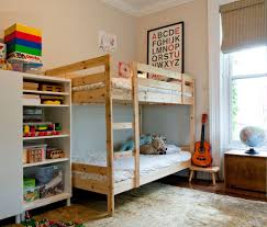 malm ikea bed for a eclectic kids with a throw pillows and