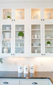 How To Clean Kitchen Cabinet Doors Love The Little Pops Of Green In With The Clean White Dishes For