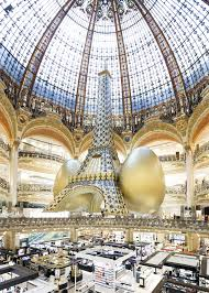 galeries lafayette siege an golden eiffel tower suspended beneath the galeries