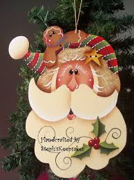 wooden painted santa and gingerbread ornament steph s
