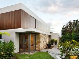 house design inside the house elegant orange exterior color design with wooden materials inside