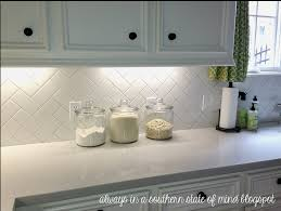 herringbone kitchen backsplash our white cabinets and new countertops now all we need is this