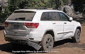 Grand Cherokee Off Road Tires Spy Shots New Grand Cherokee Looks Soft Takes Knocks Sema