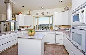 modern kitchen with travertine tile floors u0026 bay window in