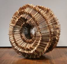 cedar wood sculpture hundreds of pieces of stacked wood form beautifully organic sculptures