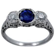 delightful art deco natural sapphire diamond engagement ring at
