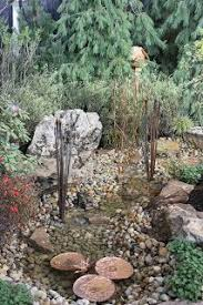 pondless water feature driftwood google search garden