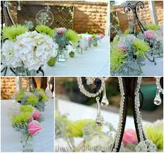 an easy summer centerpiece using a chandelier and fresh flowers