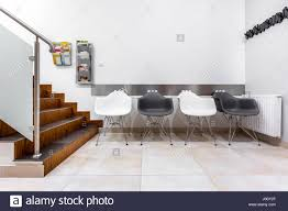 Living Room With Stairs by Modern Waiting Room With Stairs Black And White Chairs And Glass