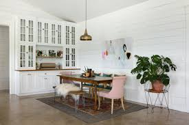 dining table with rug underneath tour a bag designer s eclectic dream barn house dining area
