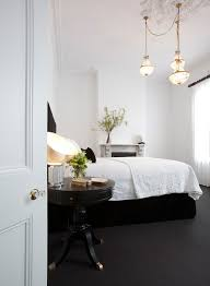 mirrored bedside table in bedroom contemporary with grey carpet