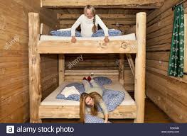 Cabin Bunk Beds Two Friends Fooling Around On Bunk Beds In Log Cabin