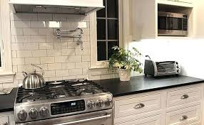 backsplash ideas for white cabinets and black countertops backsplash white cabinets dark counters thepalmahome com