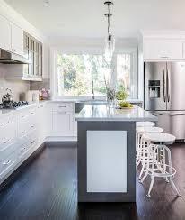 gray kitchen cabinets with white trim white and gray kitchen island with white industrial bar