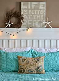 above the bed wall decor ideas with a coastal beach theme