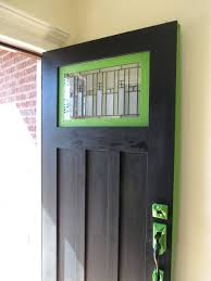 what color front door with red brick and black shutters sidelight