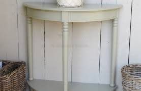 small half moon console table in white color under blue glass