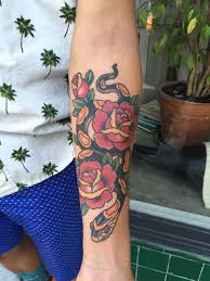 snake forearm tattoos memorial snake and roses tattoo on inner forearm by candi kinyōbi