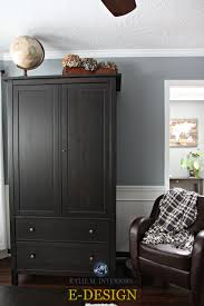 sherwin williams network gray with dark wood armoire and red tone