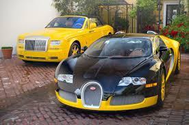 yellow bugatti file bijan bugatti veyron and rolls royce phantom drophead coupe
