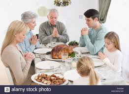 family saying grace thanksgiving table stock photos family saying