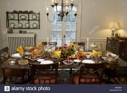 how to decorate a thanksgiving dinner table thanksgiving dining table covered festively plate turkey