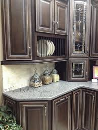 glaze finish kitchen cabinets espresso stained maple cabinets with khaki glaze dining room