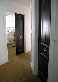paint all interior doors black or a dark cherry color to match our