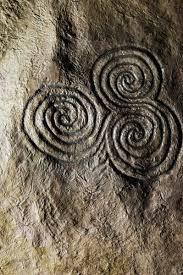 celtic triskele triple spiral stone carving newgrange ireland
