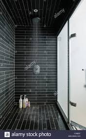 tiled wet room with running power shower stock photo