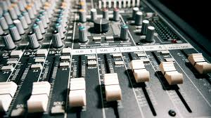 Recording Studio Mixing Desk by A Sound Engineer Using A Mixing Desk Or Mixing Console To Mix A