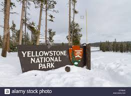 yellowstone national park entrance sign in winter stock photo