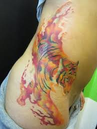tiger tattoos for arms yellow chest script
