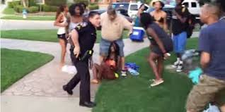 officer suspended after video of him pulling a by her braids