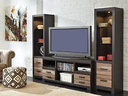 signature design by ashley harlinton large tv stand with fireplace