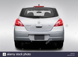 silver nissan 2008 nissan versa sl in silver low wide rear stock photo