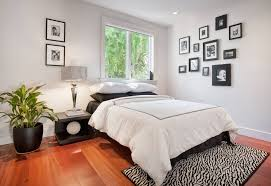 Small Bedroom Color Ideas Laminate Flooring Beside White Wooden Shelves Small Bedrooms