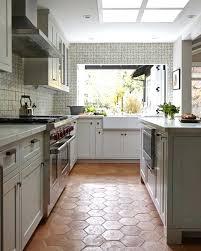 white grey brass kitchen with herringbone tile floor flooring