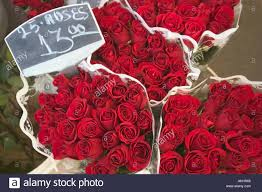 boquets of roses for sale at a flower market stock photo