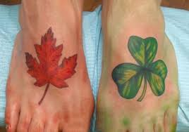 famous canadian flag leaf with nice shamrock tattoo on foot