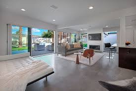 modern living room with concrete floors by neil curry zillow