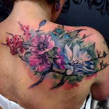 watercolor flower tattoo on shoulder back by uncl paul