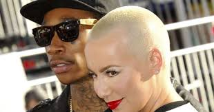 amber rose model cleans out wiz khalifa tattoo celebrities pulse