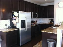 kitchen design ideas dark kitchen cabinet white subway tiles